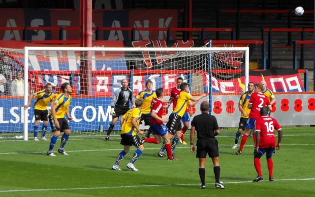 Altrincham (in yellow) defending their goal during the second half at Aldershot