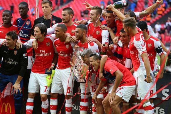 Arsenal celebrate victory over the Manchester City in the Community Shield match at Wembley Stadium, London. Photo: Gareth Fuller/PA Wire