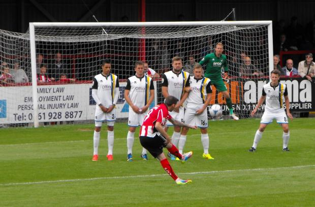 Alty's Steven Gillespie, a former Bristol Rovers player,  aims a free kick at the Rovers' goal