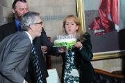 Feelgood founder and artistic director Caroline Clegg is pictured blowing out candles on the birthday cake watched by chairman of the trustees John Arnold and actor Richard Ashton who has been in a number of Feelgood productions.