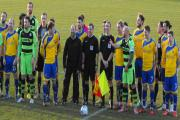 The Altrincham and Forest Green Rovers players line-up together before their match on Saturday as part of the FA's Christmas Truce campaign