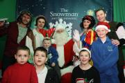 Alfie Palmer-Shaw, Alex Palmer-Shaw, Mackenzie Smith, Finley Smith and Beth Smith from Once Upon a Smile meet Santa in The Snowman and The Snowdog grotto at intu Trafford Centre, with cast members from The Magical Wood