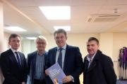 Cllr Sean Anstee, leader of Trafford Council, Mike Shields, working group chair, housing and planning minister, Brandon Lewis and Tony Collier, forum chair