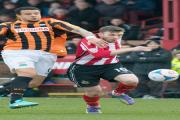 Altrincham striker Damian Reeves gets goal-side of his defender during Saturday's defeat to Barnet