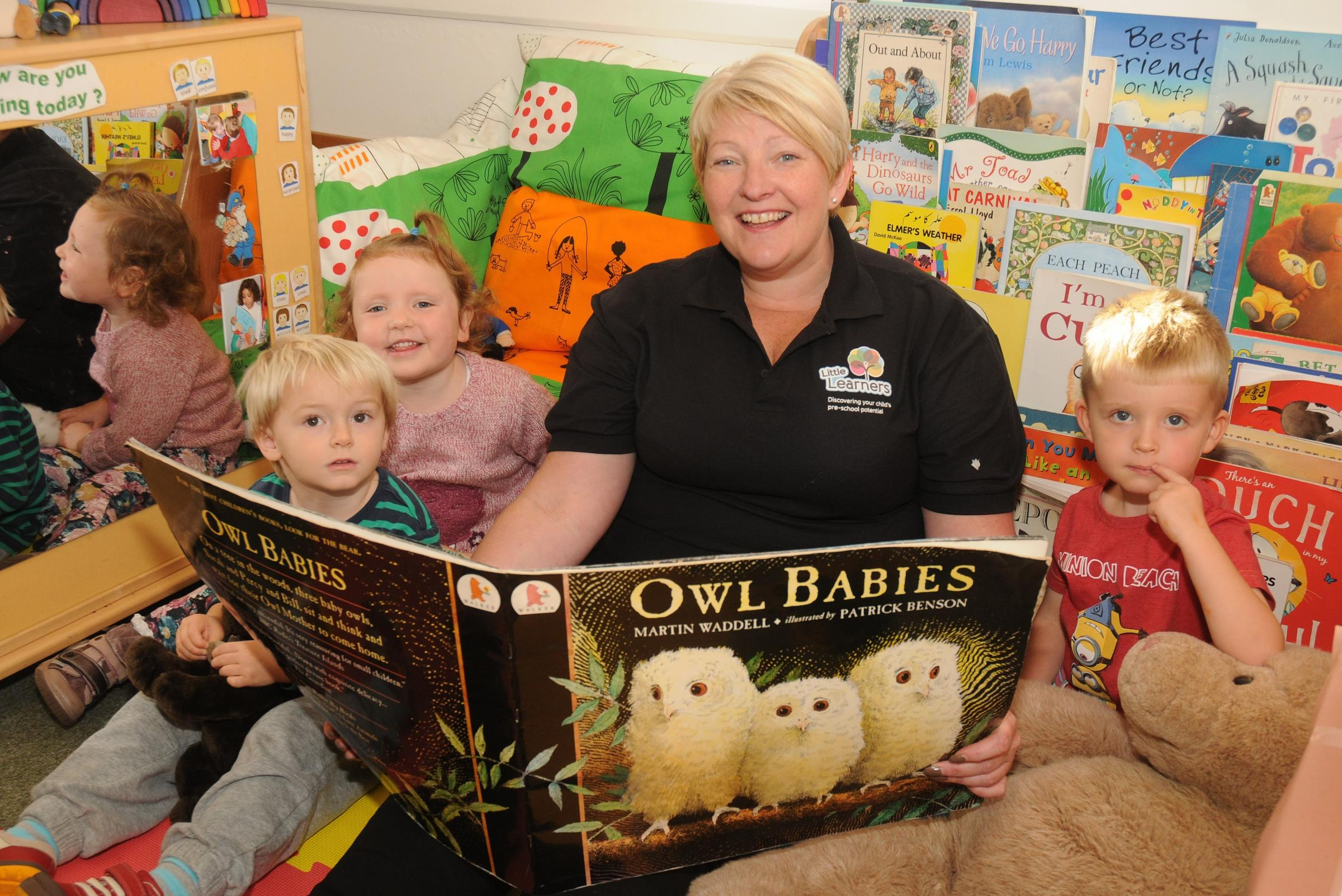 Pictured is Cathy Bellingham deputy manager with some of the children at Little Learners
