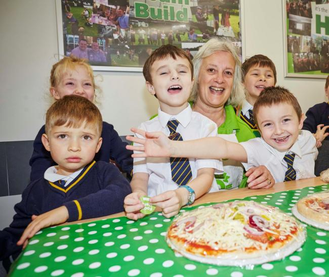 A pizza the action - the Wellfield children with Christine Ashton