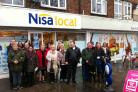 Residents unhappy about the Norris Road redevelopment plans gather outside Sale Moor's Nisa