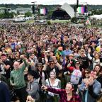 Messenger Newspapers: David Bowie fans celebrate the star in front of Glastonbury's Pyramid Stage