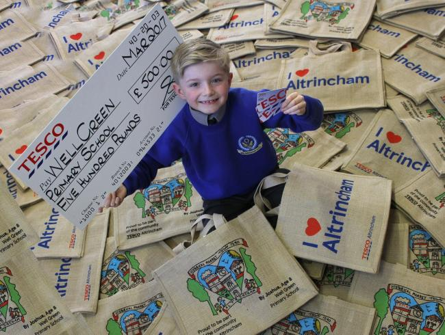 Winning pupil Joshua Hill with his limited edition bags £25 gift card and £500 donation