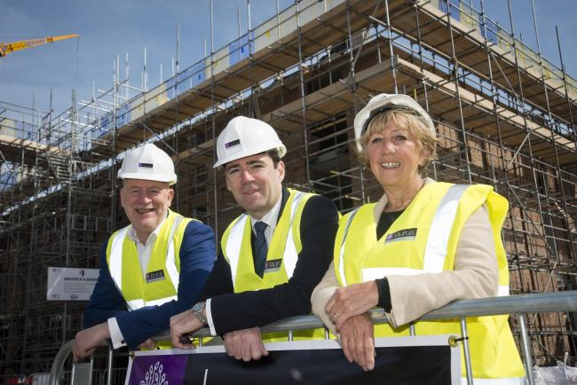 Matthew Gardiner, THT chief executive, Andy Burnham MP and Edna Robinson THT Chair visiting The Maples sites on Cross Street, Sale