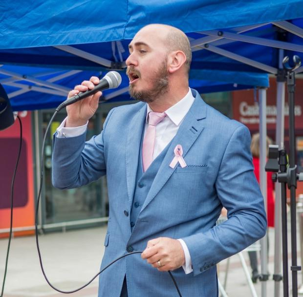 Messenger Newspapers: Singer Wayne Devlin put on a performance for the Paint Urmston Pink event on April 15