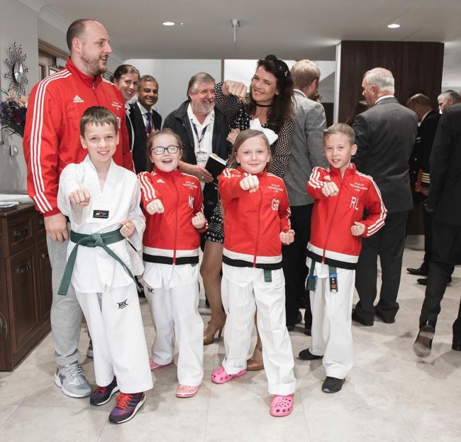 Annabel Croft presented youngsters from Manchester Sport Taekwondo with a cheque, on behalf of Kingsely Healthcare