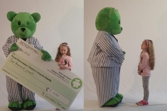 Holly hands over funds raised by her father's colleagues to thank hospital for saving her life