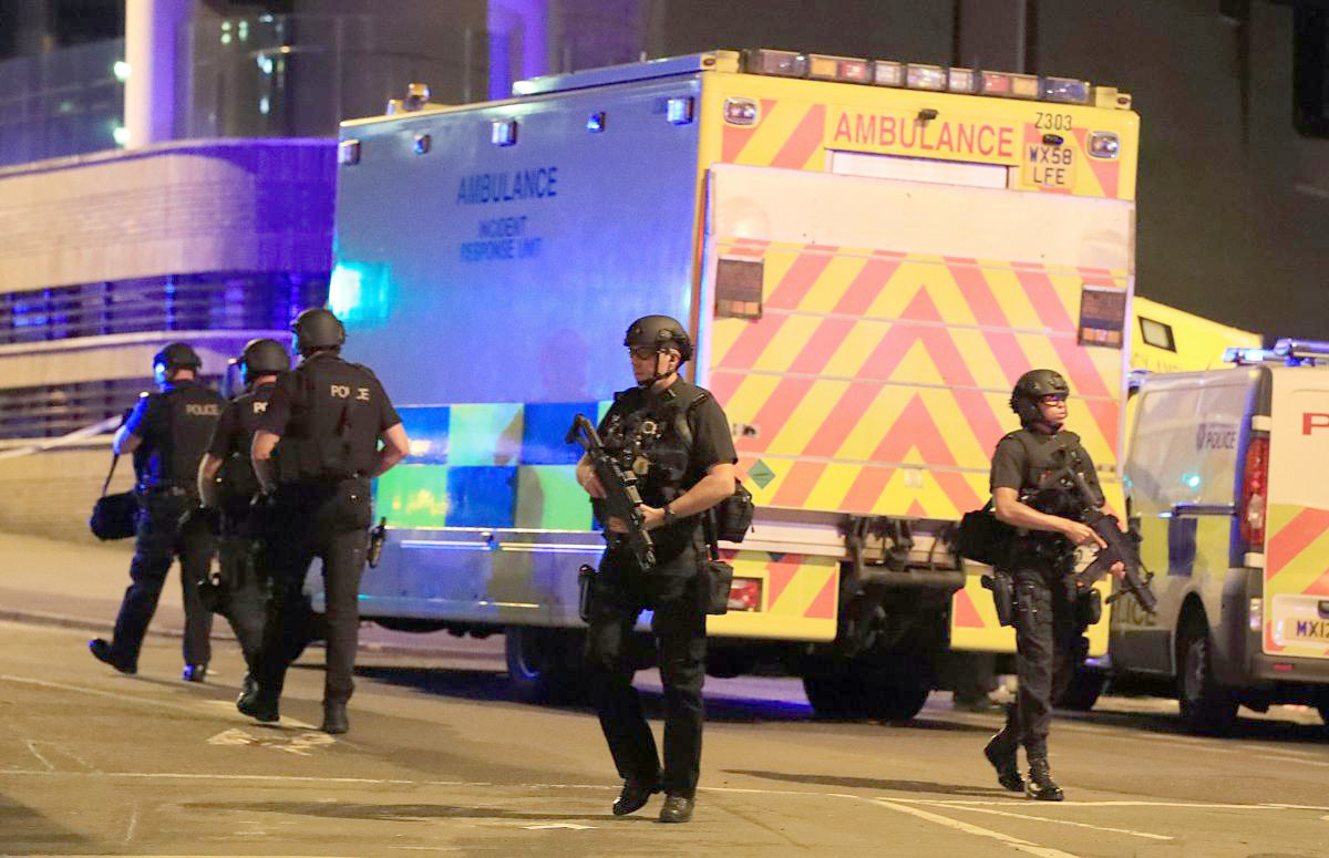 Police at the scene as a suicide bomber killed 22 people and seriously injured dozens more at the Manchester Arena. Picture: PA.