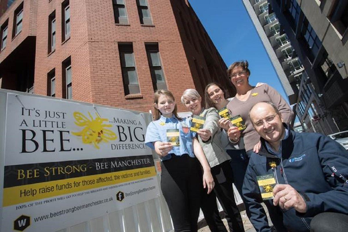 (L-R): Millie and Kim Fraser with Emma, Helen and Simon Bower at the Russells Construction site in Brown Street