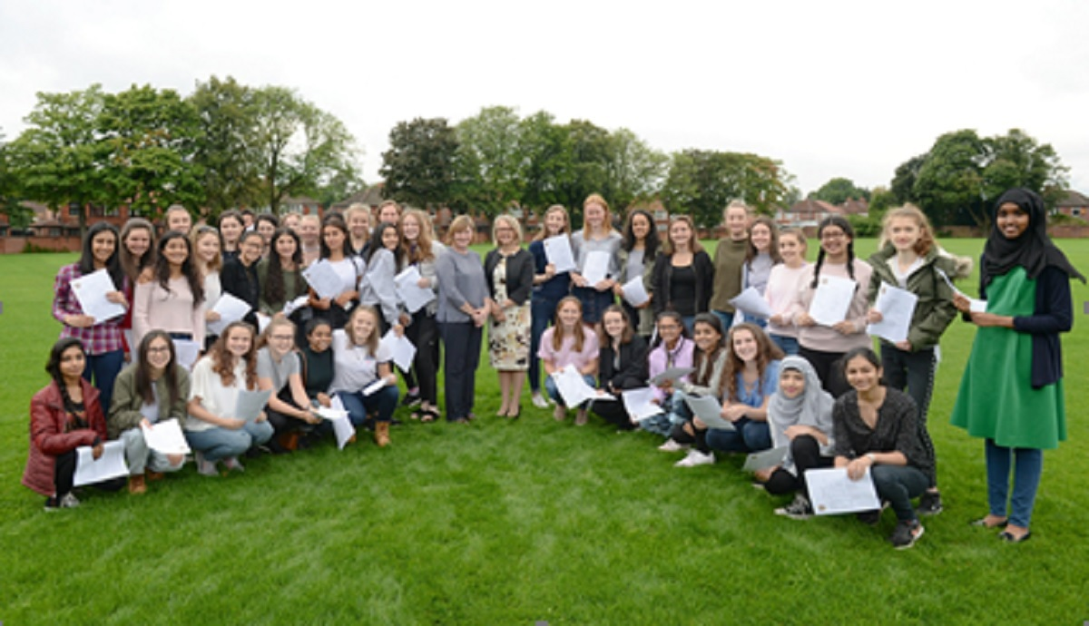 Withington Girls' School students celebrate outstanding GCSE results, with 93 per cent of all papers taken awarded the top A* to A or 9 to 7 grades.  Centre are head of Year 11 Mrs Mhairi Ferrol (left) and Withington headmistress Mrs Sarah Haslam right