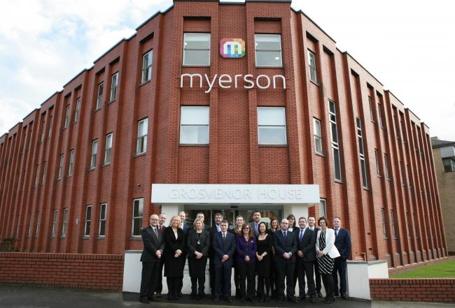 Myerson staff in front of their office.