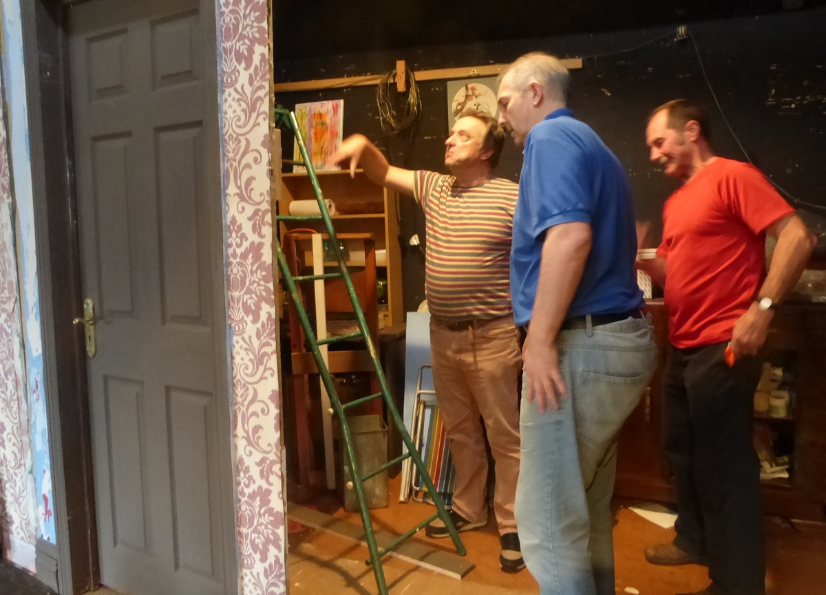 Working on the set - left to right - Peter Holstein, stage manager, Colin Baker, cast member, Arthur Hulse, cast member.