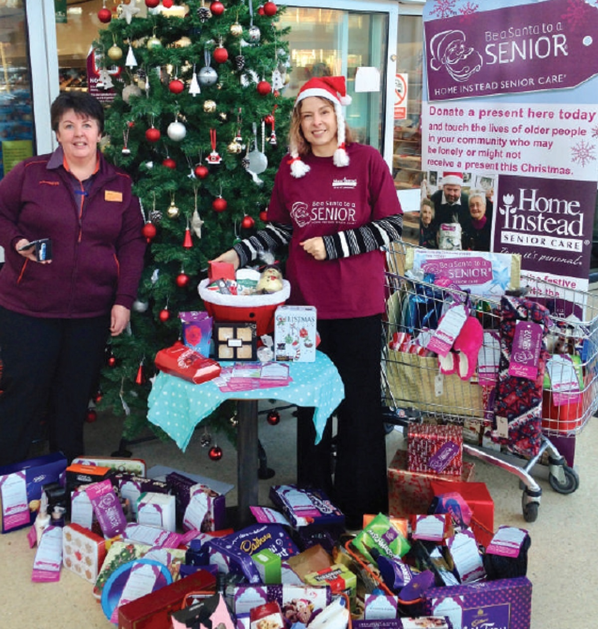 Messenger readers are being urged to support Home Instead's 'Be a Santa to a Senior' Christmas present appeal by (l to r) Jackie Mcmahon (Sainsbury's Sale's community liaison manager) and Liz Rhodes (Home Instead Senior Care (Altrincham & Sale