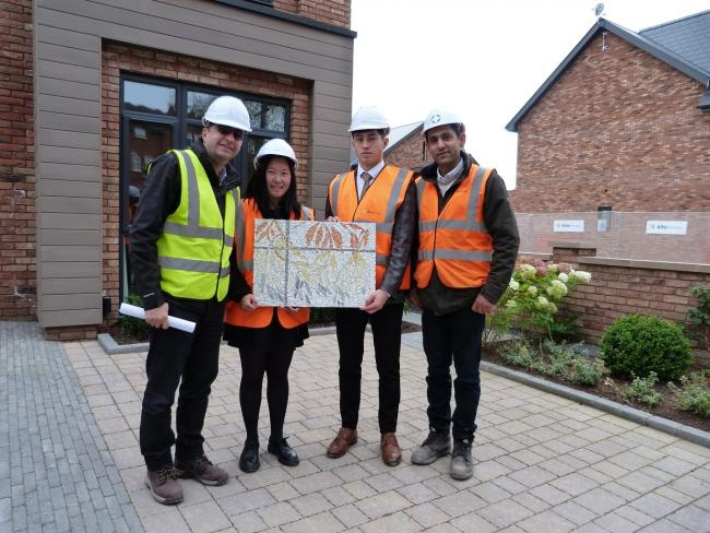 The plaque handover - Yousef Mousavi, design director; Sale Grammar school pupils Stephanie Chiu and Jarrod Townson and Altin Homes site manager, Navid Elahi