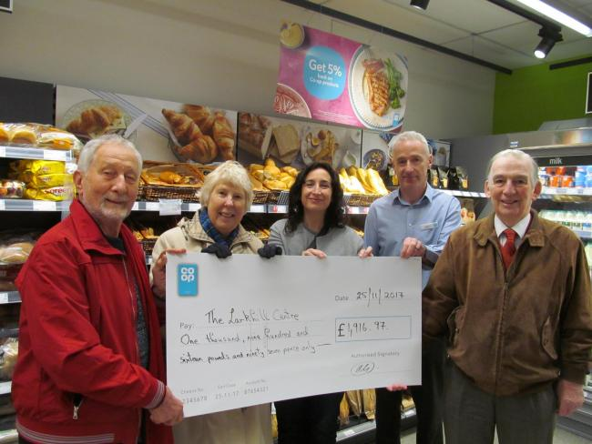 The Larkhill Centre Community Association, Michael Rose and Zoe Woodhead, CEO Food at the Co-op, Jo Whitfield, Co-op store manager, Rob McClement and Rod Woodhead from The Larkhill Centre Community Association at the Co-op on Stockport Road in Timperley