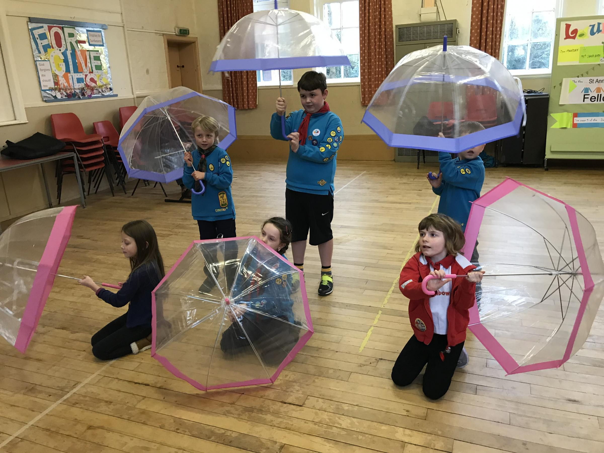 Rainbows and Beavers practising for Singing in the Rain