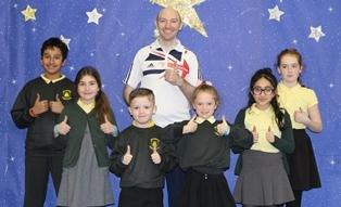 Michael Churn with pupils at Broomwood Primary School