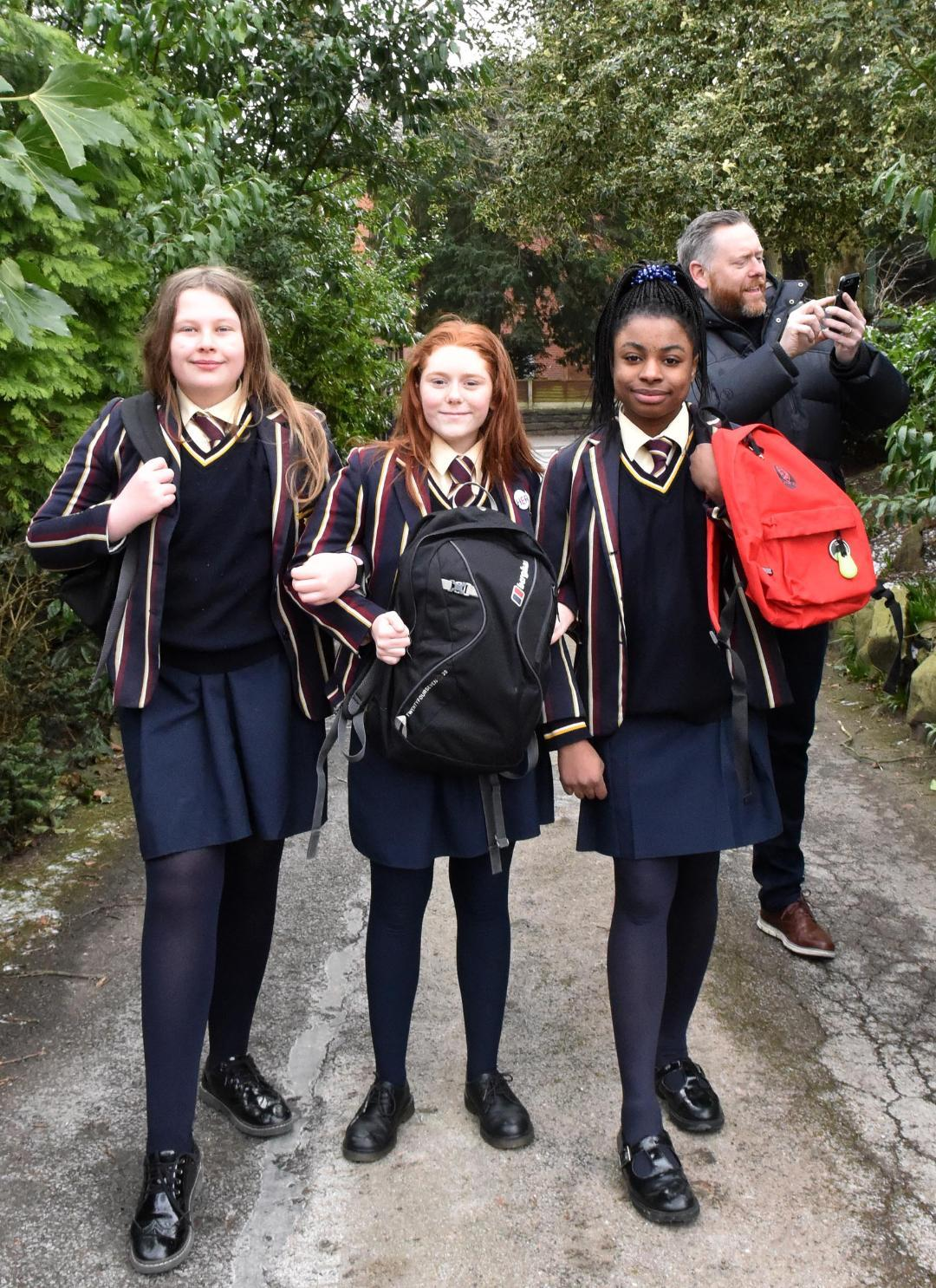 With once worried dad James Beazley in the background are from left, Katie Wilkinson, Flora Beazley and Miriam Oronsaye with their bags that have been transformed into tracking devices