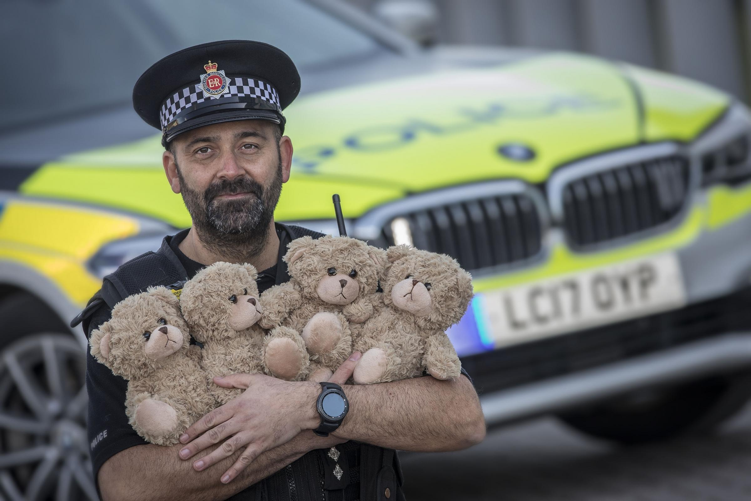 COMFORT: Chief Inspector Tariq Butt with donated teddies to give to children involved in road traffic collisions