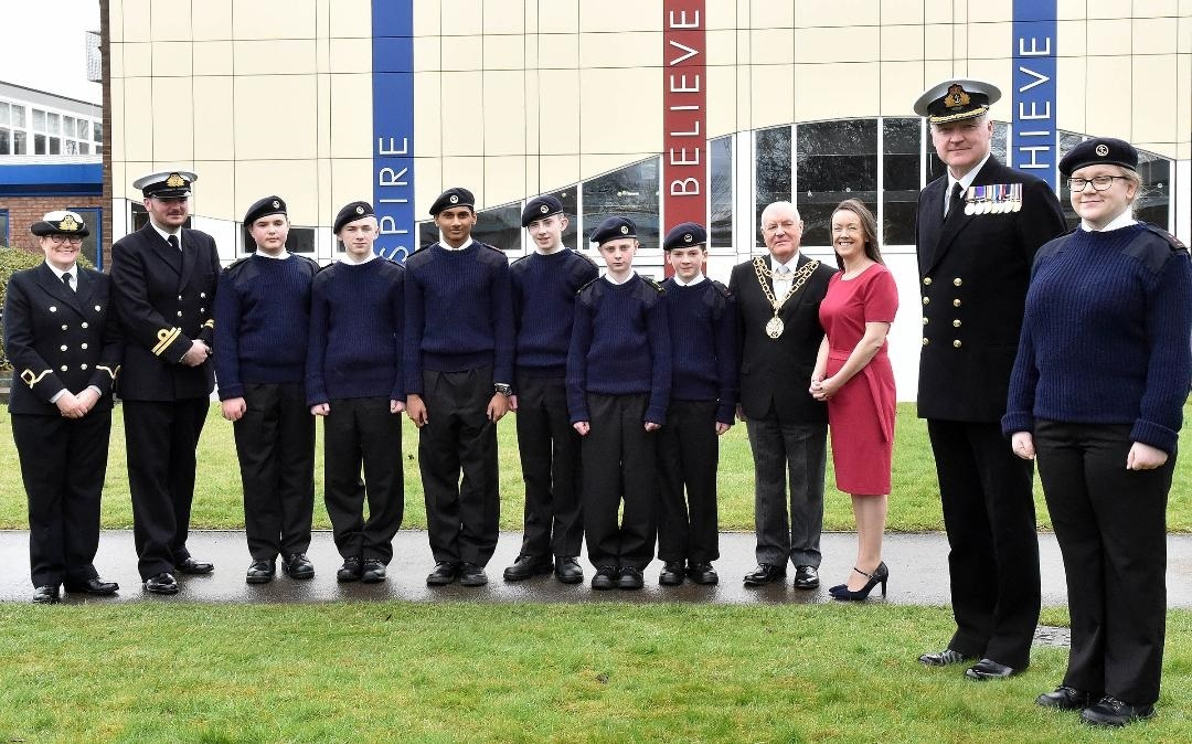 Commander Bernard Thompson, Naval Regional Command North East, Chief of Staff, with Royal Naval cadet Natasha Radford and fellow cadets and dignitaries at CCF opening ceremony at St. Antony's Catholic College