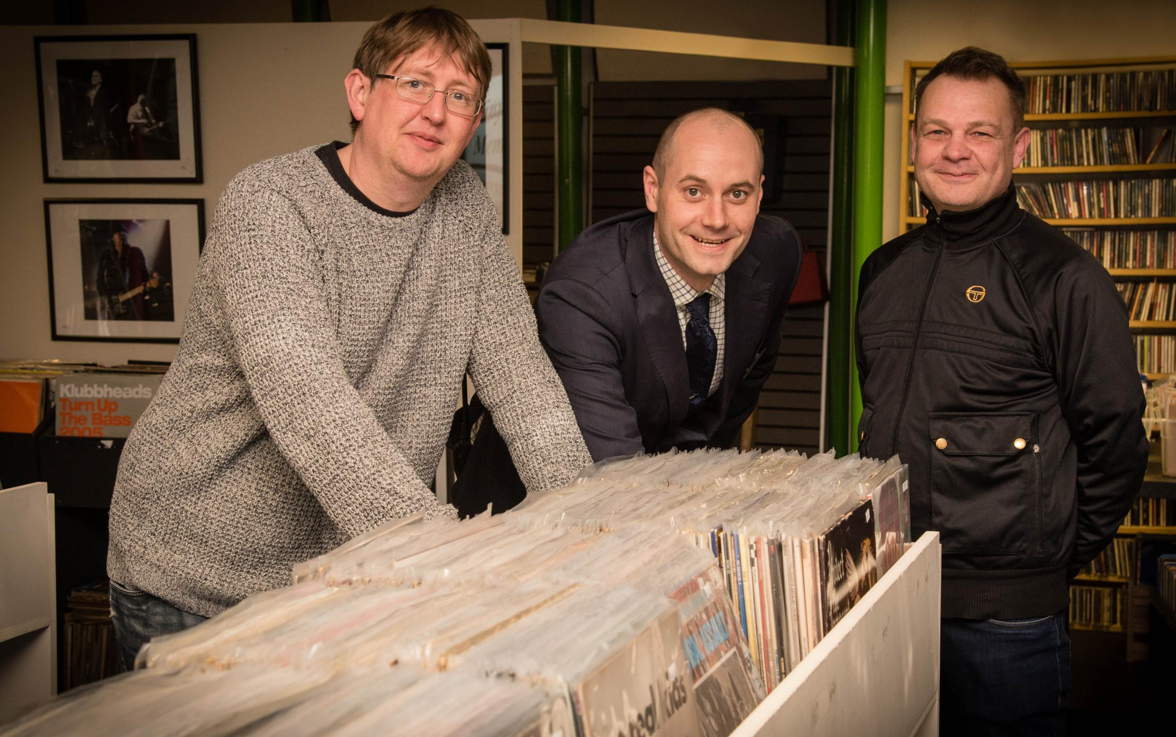 Nigel Young, left and Rick Jones with Stretford Mall Operations Manager Craig Topping, centre at Reel Around the Fountain Records