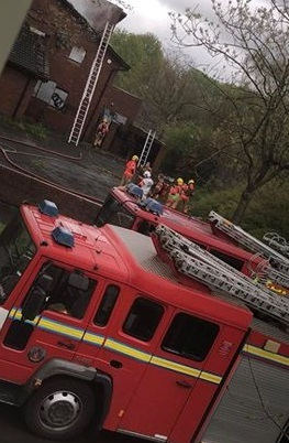 Firefighters at the Red Brook pub in Oak Road in Partington