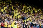 Watford fans wave flags during last season's draw with Liverpool