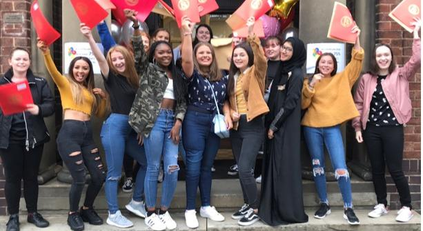 Flixton Girls' School students celebrate: From left to right front row: Robyn Tia Sharp, Lia Norton, Lana Walker, Eden Woodstock-Burgher, Centre Front: 3 House Captains; Esme Williams, Katie Scotson & Ammal Shahid, Right Front: Natasha Lam Ella Cr