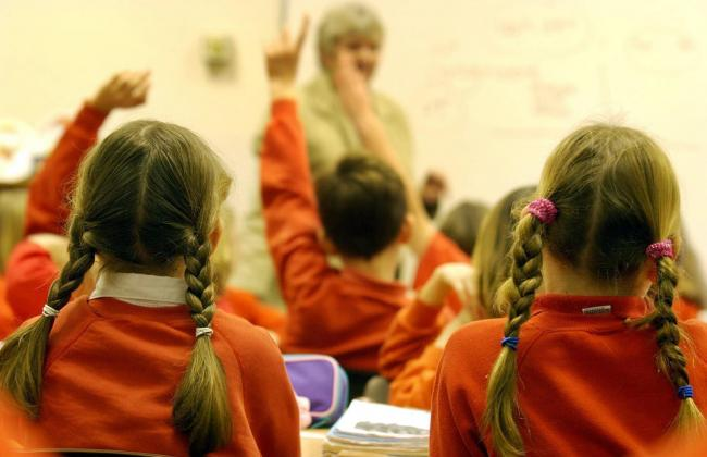File photo dated 03/12/03 showing young primary school children. Education Secretary Damian Hinds has announced proposals to scrap the system of two standards to hold schools in England to account for their performance and replace them with a new single m