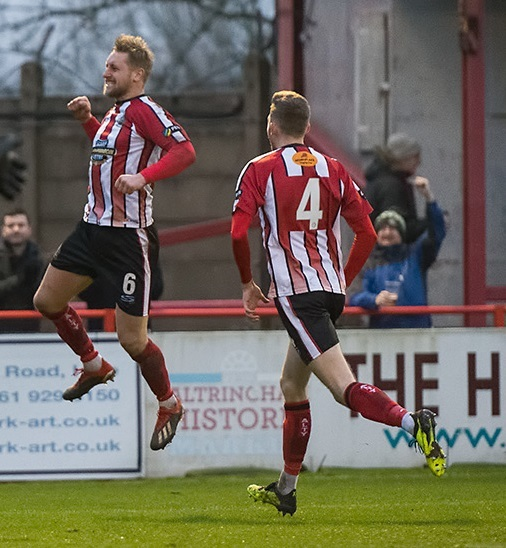 WINNER: Altrincham's Jake Moult, left, celebrates his goal against Southport. Picture by Michael Ripley Photography