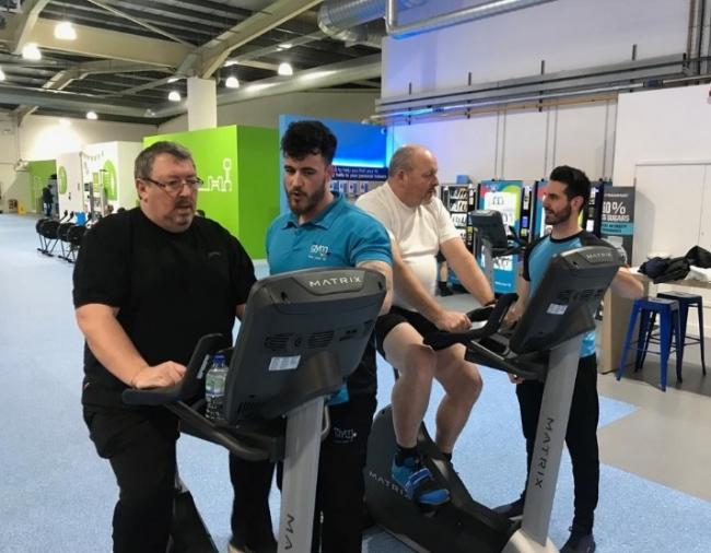 Altrincham FC director Neil Faulkner, left, and commercial manager Noel Shield are put through their paces by The Gym general manager Phillip Ravenscroft and his assistant Kyle Harris
