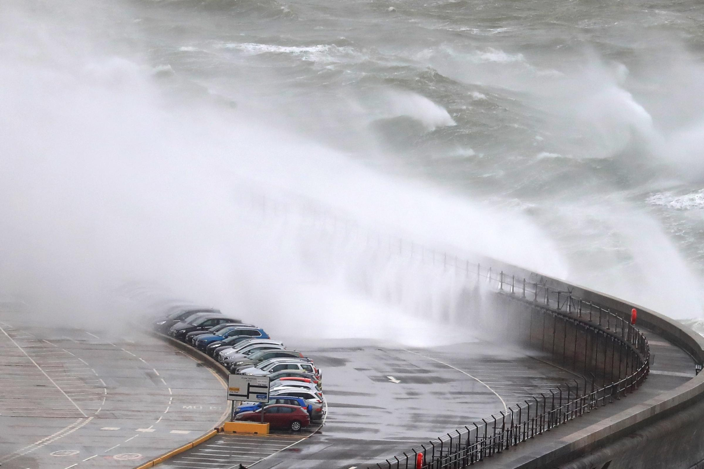 Waves crash onto cars on the harbour arm at the Port of Dover in Kent as Storms Gareth sweeps across the country (Gareth Fuller/PA)