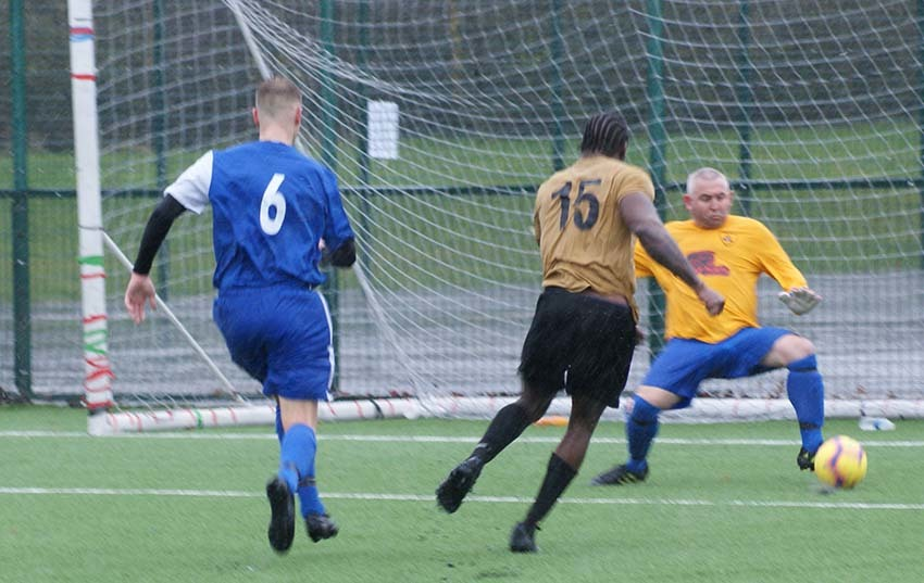 Action from Radclyffe (blue) v Urmston Town