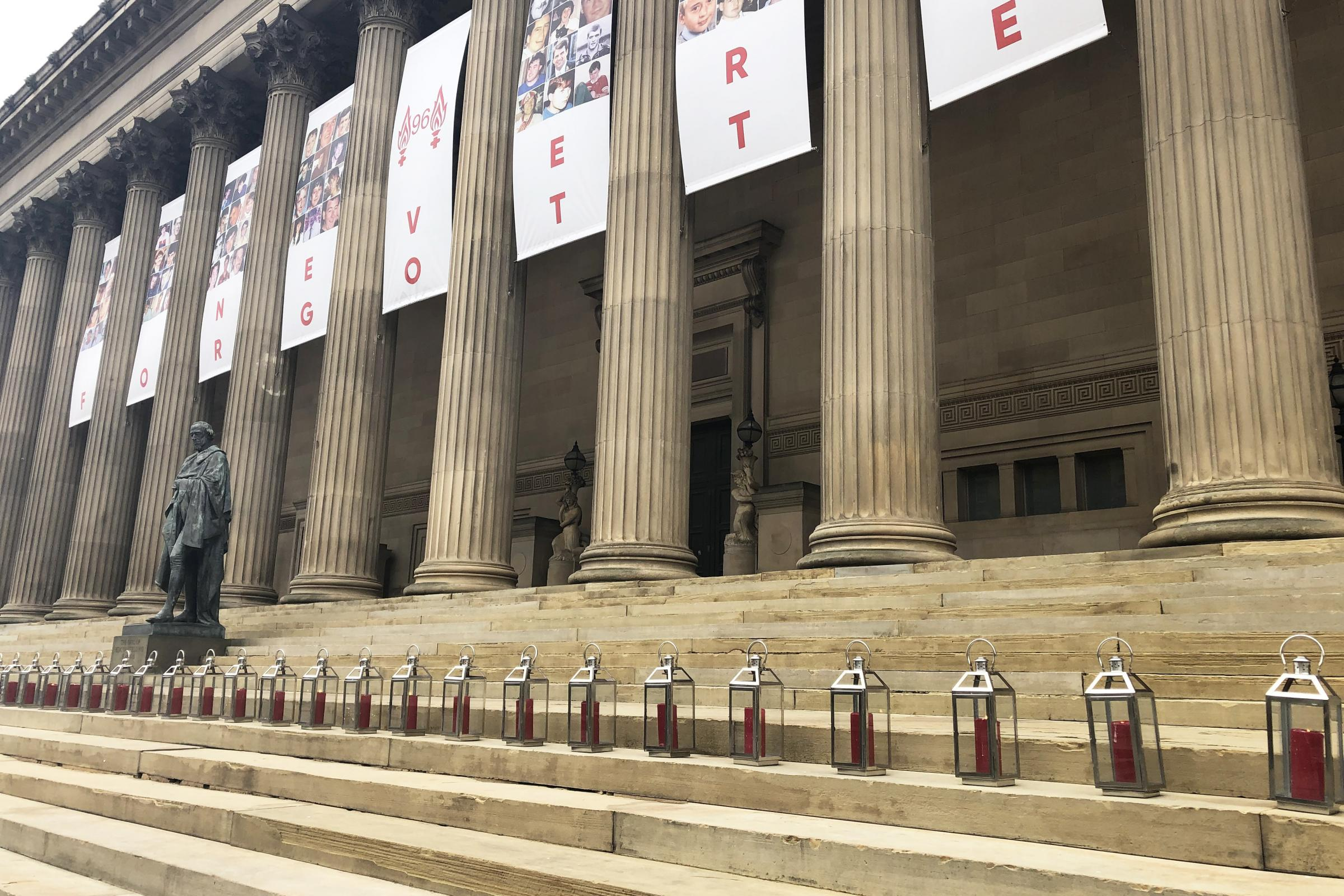 Ninety-six lanterns are lit on the steps of St George's Hall in Liverpool