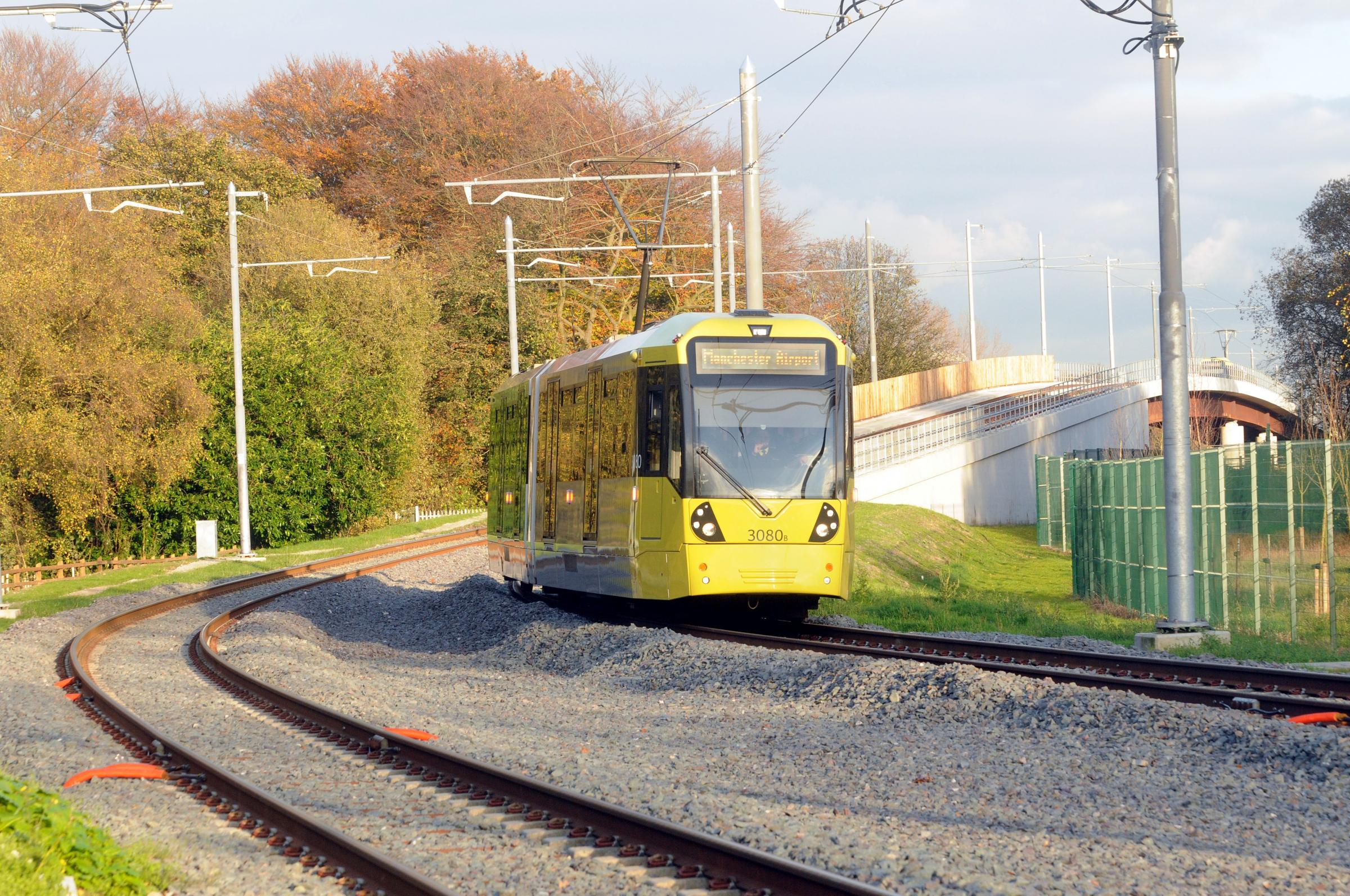 Metrolink Manchester airport tram at Sale waterpark..
