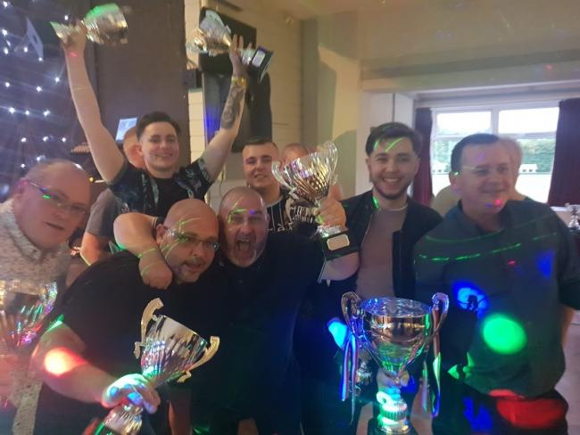 Jolly Butcher celebrate their trophy haul