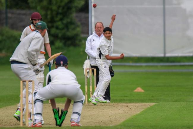 Teenager Arran Sen in bowling action for Stretford