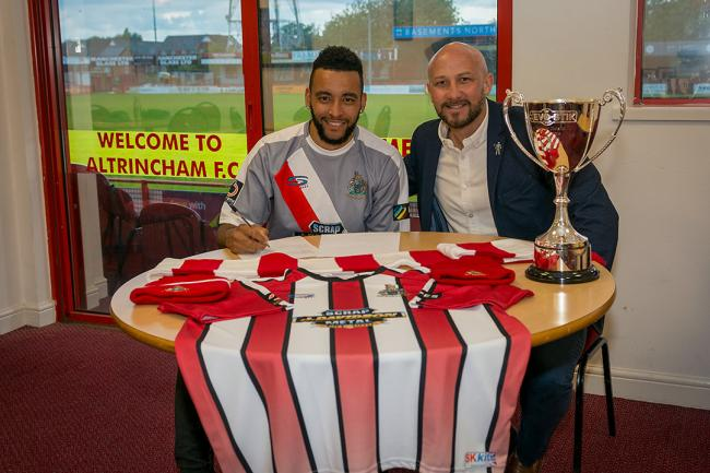 NEW FACE: Alty signing Nathan Arnold, left, puts pen to paper with Phil Parkinson. Picture by Michael Ripley Photography